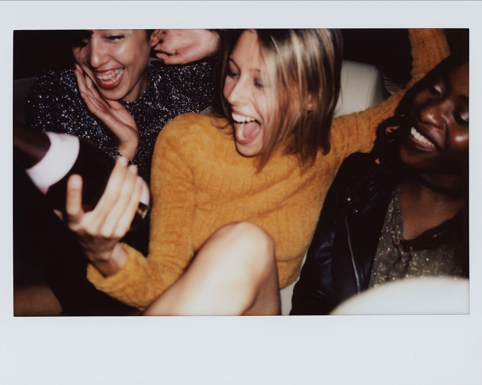 three smiling woman